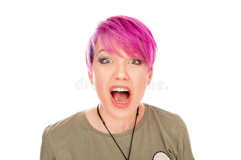 Angry young woman shocked screaming. Isolated on white background. Studio shot horizontal image. Millennial model with pink magenta hair. Stunned, surprised stock images