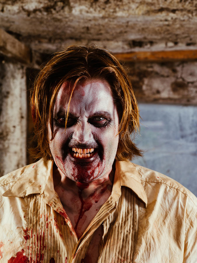 Angry zombie hungry for brains stock photo