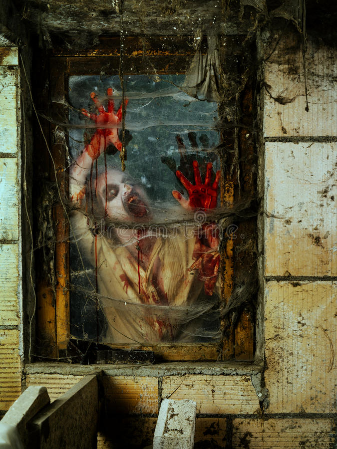 Angry zombie at the window royalty free stock photo