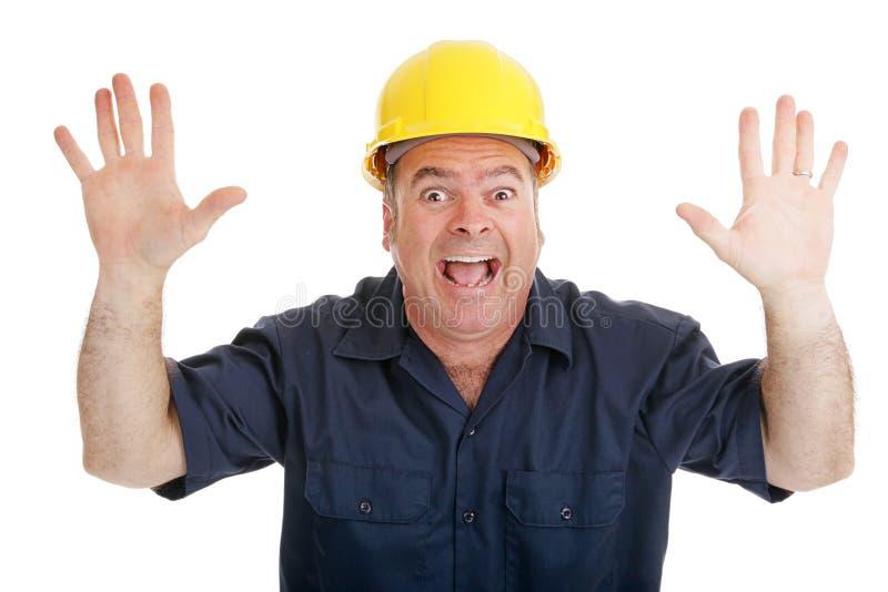 Angst aangejaagde bouwvakker stock afbeelding