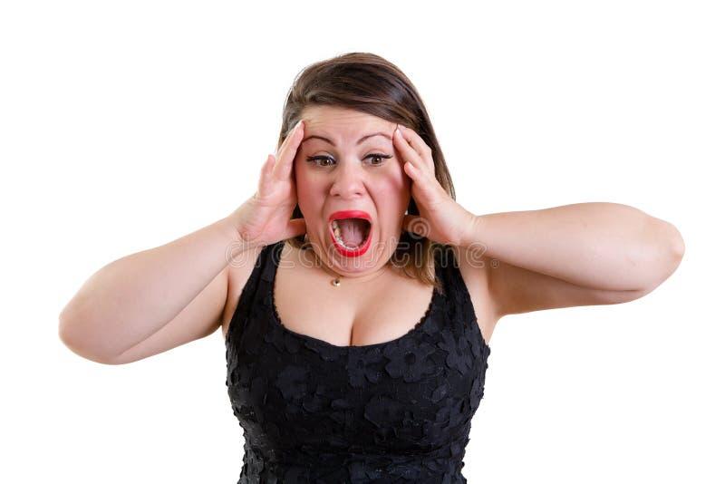 Angst aangejaagde vrouw die haar hoofd met beide handen houden stock afbeelding