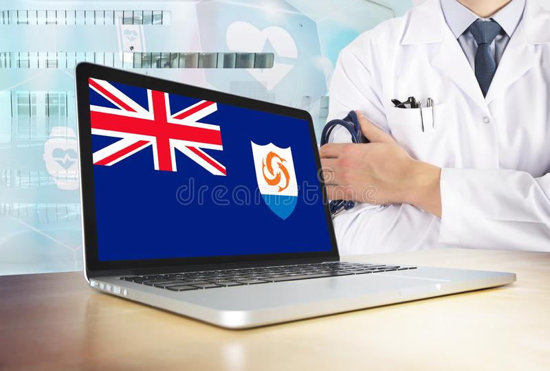 Anguilla healthcare system in tech theme. Anguillian flag on computer screen. Doctor standing with stethoscope in hospital. Cryptocurrency and Blockchain stock images