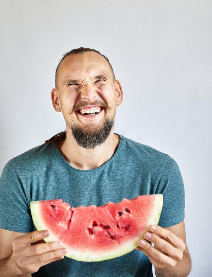 Anguria mangiatrice di uomini felice immagine stock