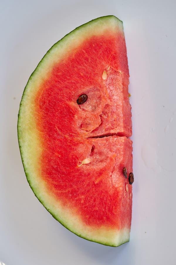Anguria rossa affettata per estate illustrazione di stock
