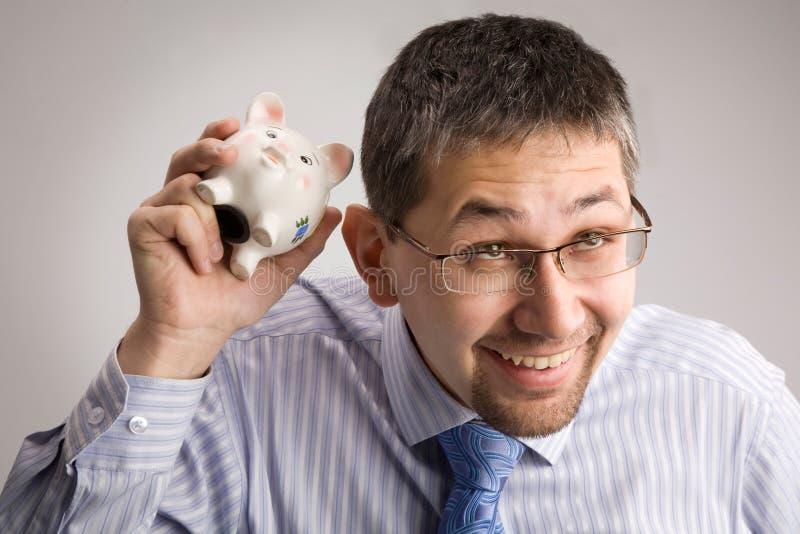 Anhalten von einer piggy Querneigung lizenzfreie stockfotografie