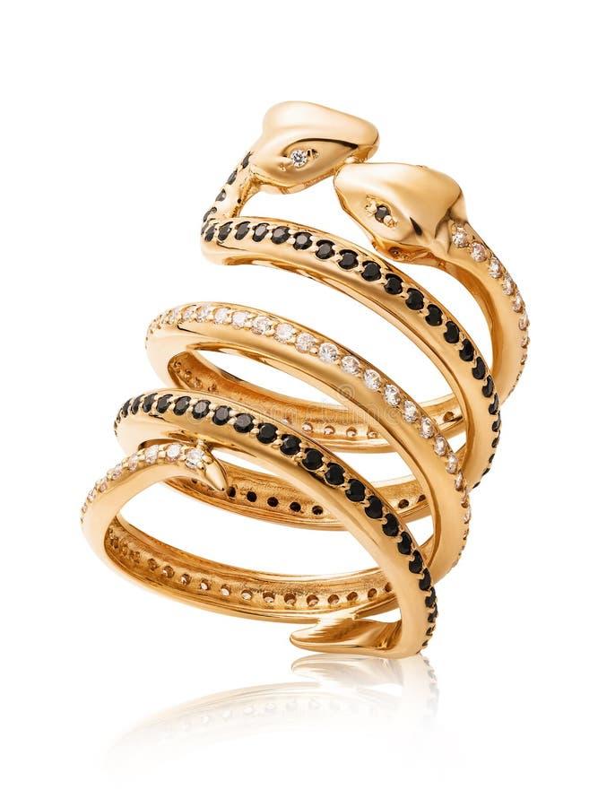 Anillo de oro bajo la forma de besar serpientes con las circonas cúbicas y los diamantes negros aislados foto de archivo libre de regalías