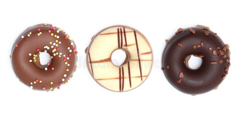 Anillos de espuma del chocolate imagenes de archivo