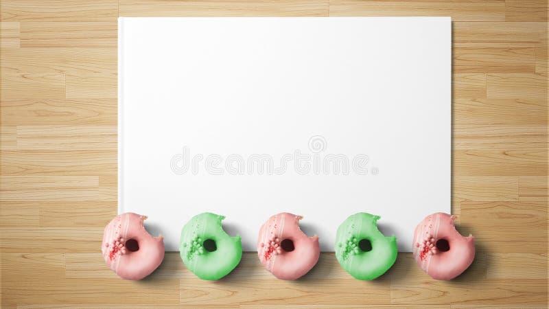 Anillos de espuma en el Libro Blanco en fondo de madera foto de archivo libre de regalías