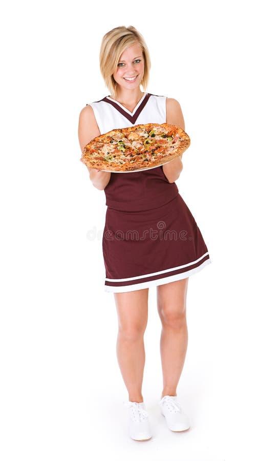 Animadora: Mujer que sostiene la pizza suprema entera foto de archivo