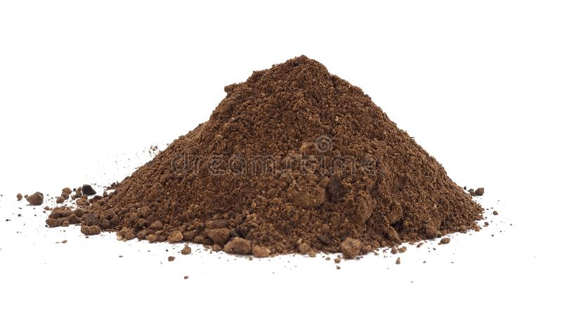 Palm kernel meal powder with shell by product from oil production and substrate of cosmetic isolation on white background stock images