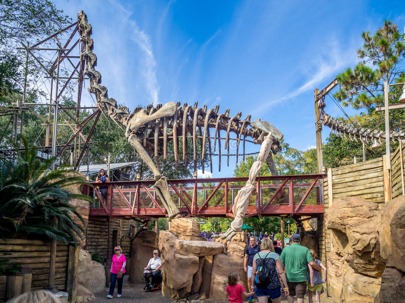 Animal Kingdom Theme Park, Dinsey World. Crowds enjoy the Animal Kingdom Theme Park at Disney World in Orlando Florida. Visible are attractions in the DinoLand royalty free stock images