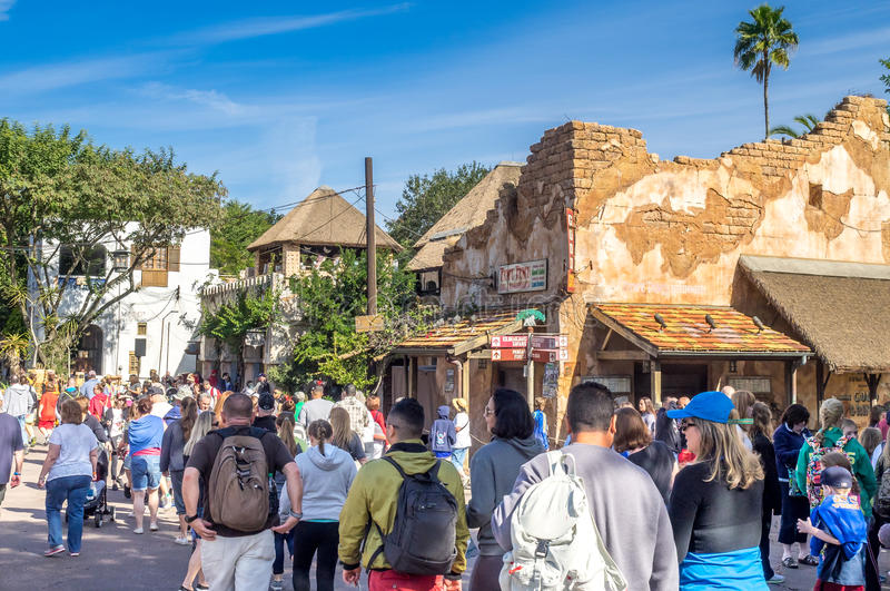 Animal Kingdom Theme Park, Dinsey World. Crowds enjoy the Animal Kingdom Theme Park at Disney World in Orlando Florida. Visible are buildings in the African stock photography