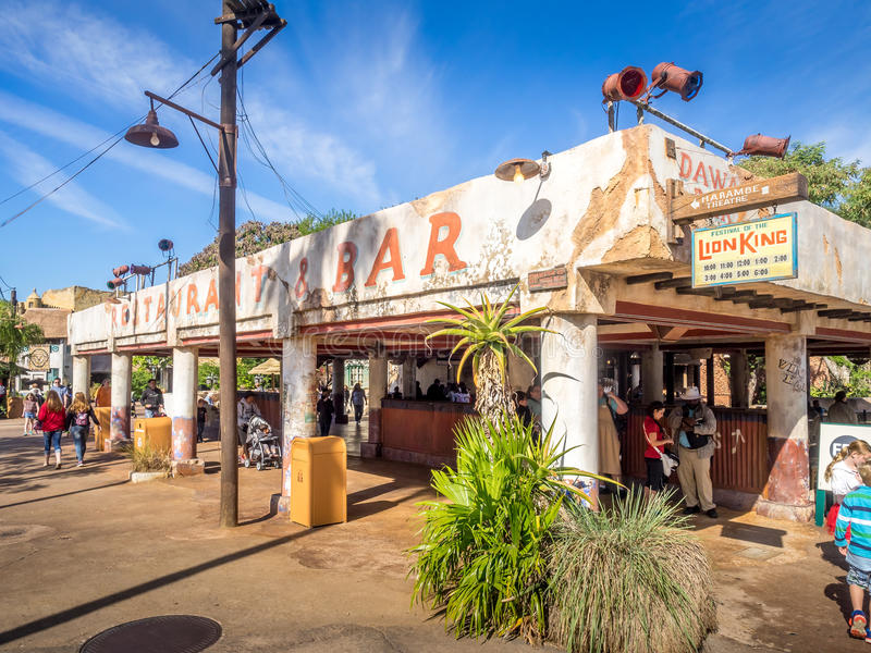 Animal Kingdom Theme Park, Dinsey World. Crowds enjoy the Animal Kingdom Theme Park at Disney World in Orlando Florida. Visible are buildings in the African royalty free stock photo