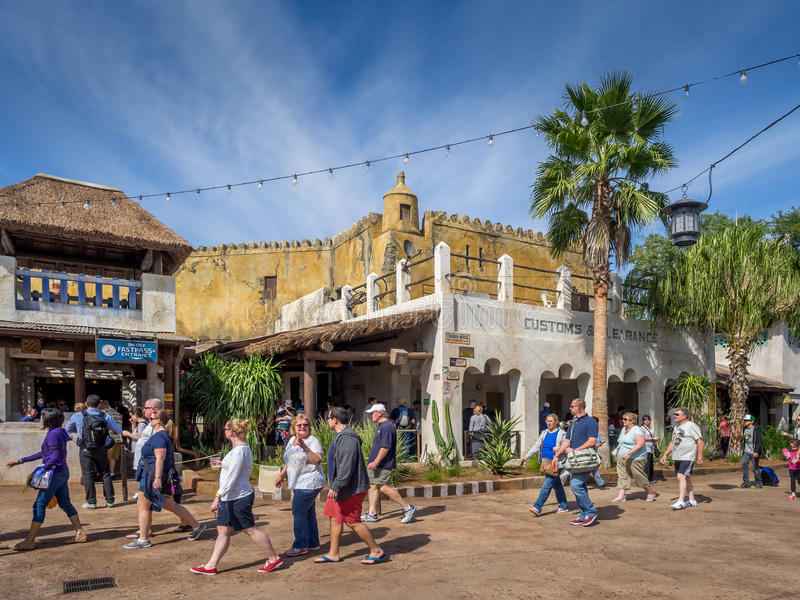 Animal Kingdom Theme Park, Dinsey World. Crowds enjoy the Animal Kingdom Theme Park at Disney World in Orlando Florida. Visible are buildings in the African royalty free stock image