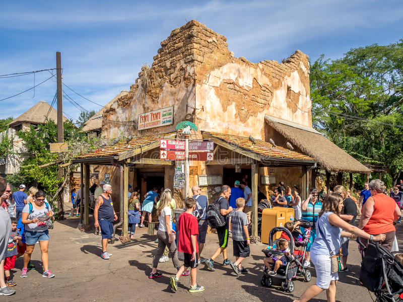 Animal Kingdom Theme Park, Dinsey World. Crowds enjoy the Animal Kingdom Theme Park at Disney World in Orlando Florida. Visible are buildings in the African stock photos