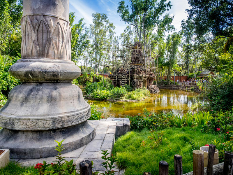 Animal Kingdom Theme Park, Dinsey World. Crowds enjoy the Animal Kingdom Theme Park at Disney World in Orlando Florida. Visible are buildings in the Asia section royalty free stock photos