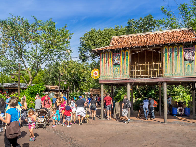 Animal Kingdom Theme Park, Dinsey World. Crowds enjoy the Animal Kingdom Theme Park at Disney World in Orlando Florida. Visible are buildings in the Asia section stock photos