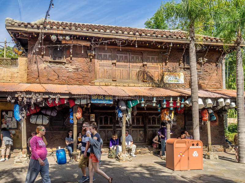 Animal Kingdom Theme Park, Dinsey World. Crowds enjoy the Animal Kingdom Theme Park at Disney World in Orlando Florida. Visible are buildings in the Asia section stock photography
