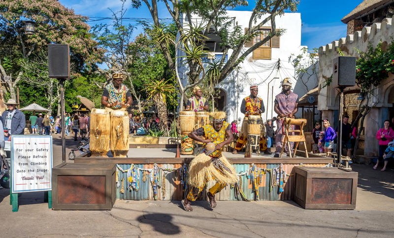Animal Kingdom Theme Park, Dinsey World. Crowds enjoy the Animal Kingdom Theme Park at Disney World in Orlando Florida. Visible are performers in the African royalty free stock image