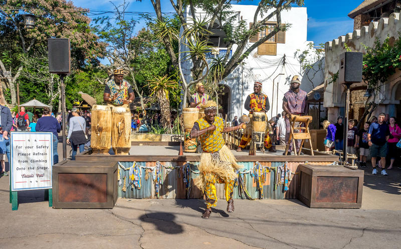 Animal Kingdom Theme Park, Dinsey World. Crowds enjoy the Animal Kingdom Theme Park at Disney World in Orlando Florida. Visible are performers in the African stock photo