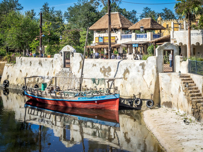 Animal Kingdom Theme Park, Dinsey World. The Animal Kingdom Theme Park at Disney World in Orlando Florida. Visible is a boat and buildings in the African section stock photos