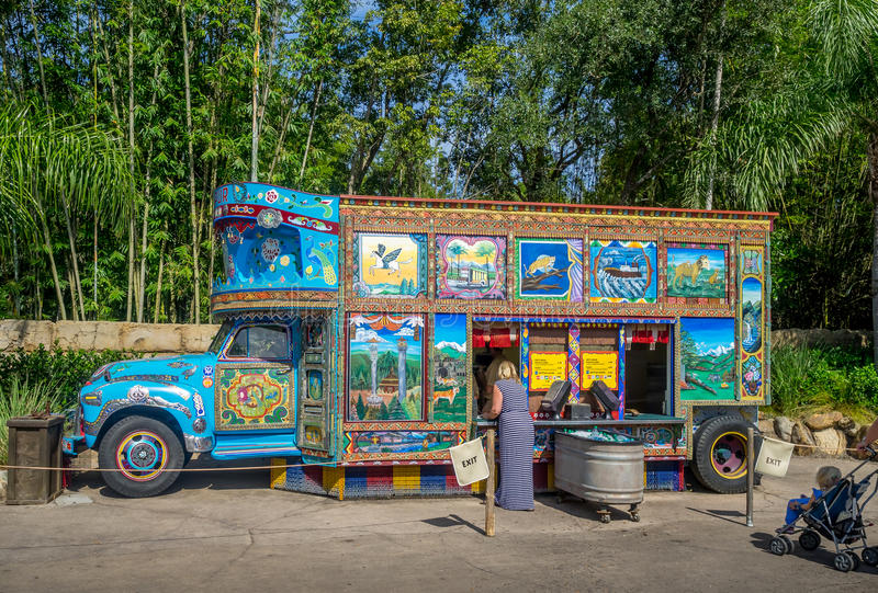 Animal Kingdom Theme Park, Dinsey World. Food Truck at the Animal Kingdom Theme Park at Disney World in Orlando Florida. Visible is a very colorful food truck in stock photos
