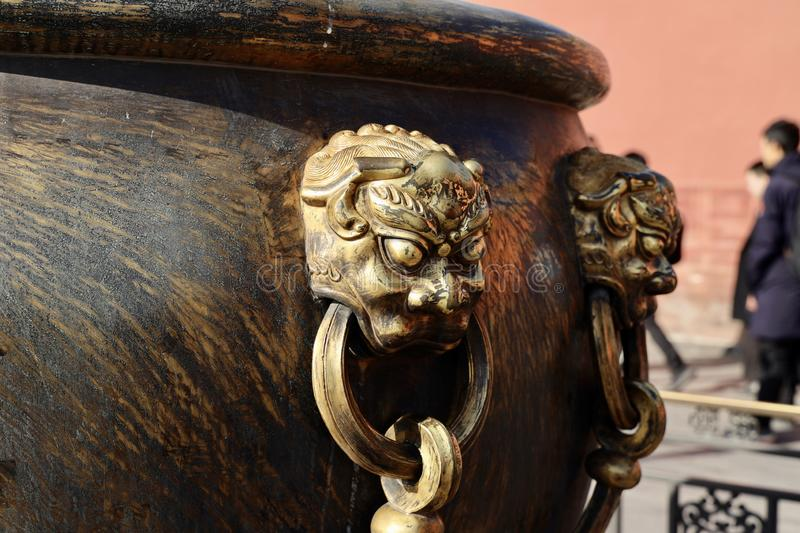 The animal mask on the copper vat in forbidden city stock images