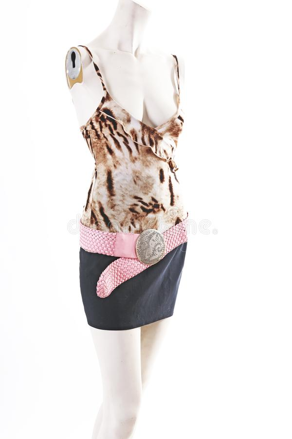 Animal pattern top black skirt on mannequin full body shop display. Woman fashion styles, clothes on white studio royalty free stock photos