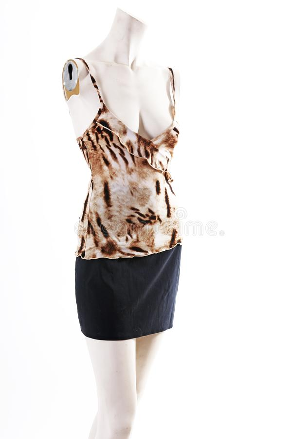 Animal pattern top black skirt on mannequin full body shop display. Woman fashion styles, clothes on white studio background. royalty free stock photo