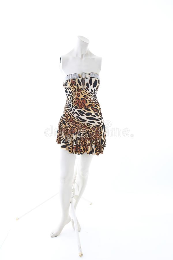 Animal pettern mini dress on mannequin full body shop display. Woman fashion styles, clothes on white studio background.  stock images