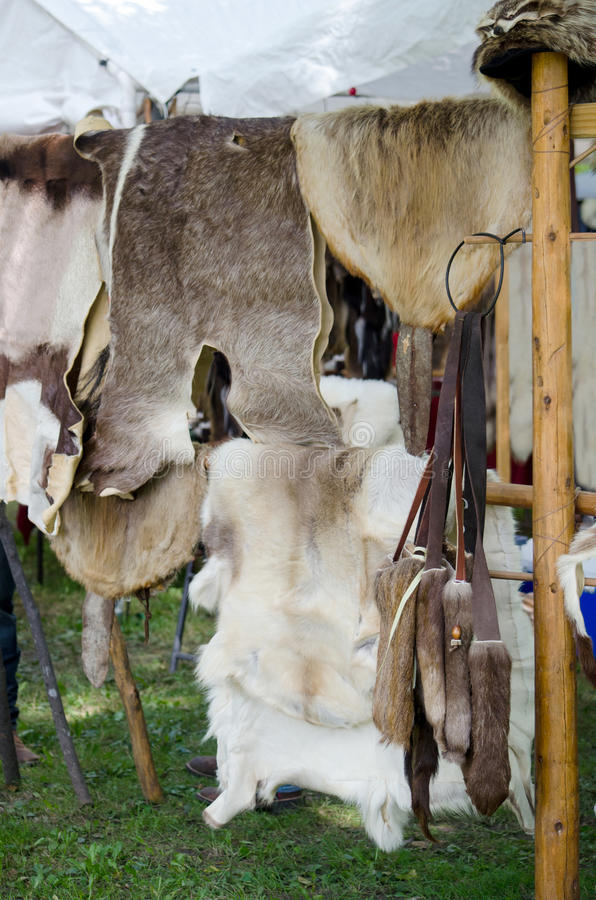 Animal skins and pelts for sale. Animal skins and fur pelts are displayed for sale at an indian pow wow royalty free stock photos