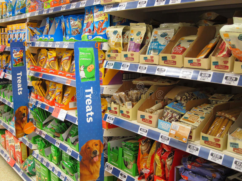 Animal treats in a pet store. Shelves of animal treats in a pet store. items consist mainly of dog food used to treat or train them stock image
