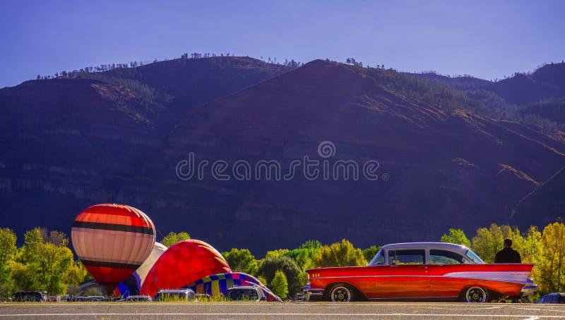 Animas Valley Balloon Rally with a 1957 Chevy stock image