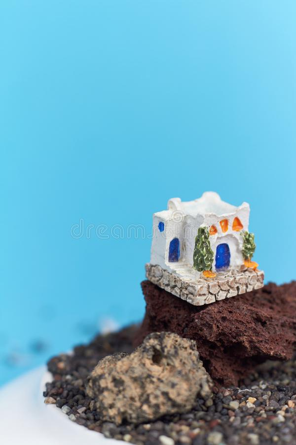 Animated model of a Greek house on a rock on a neon and pink background. royalty free stock image