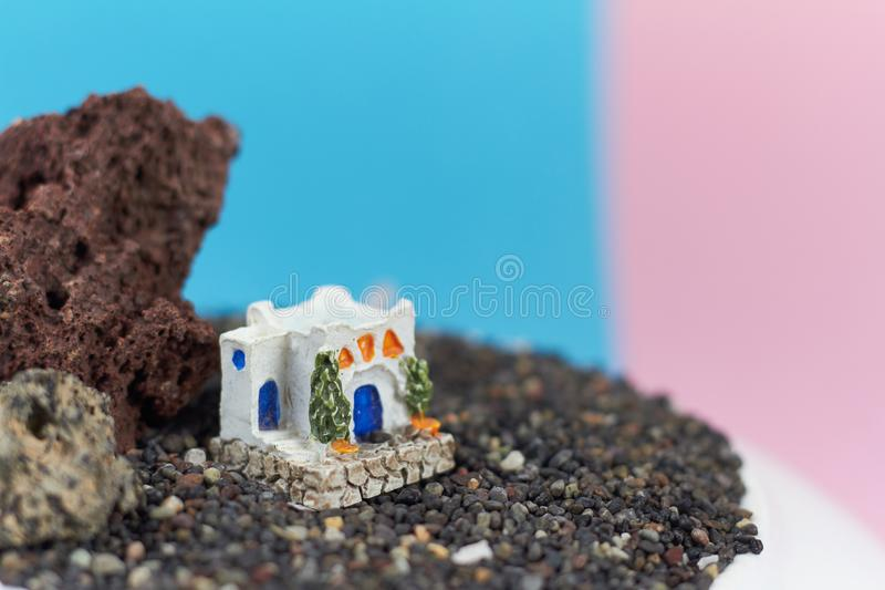 Animated model of a Greek house on a rock on a neon and pink background. Animated model of a Greek house on a rock on a neon and pink background stock photos