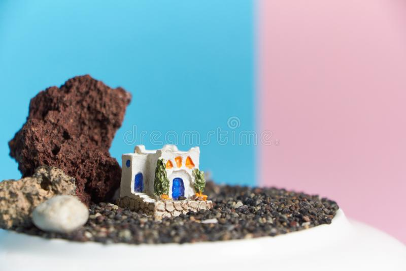 Animated model of a Greek house on a rock on a neon and pink background. royalty free stock photos