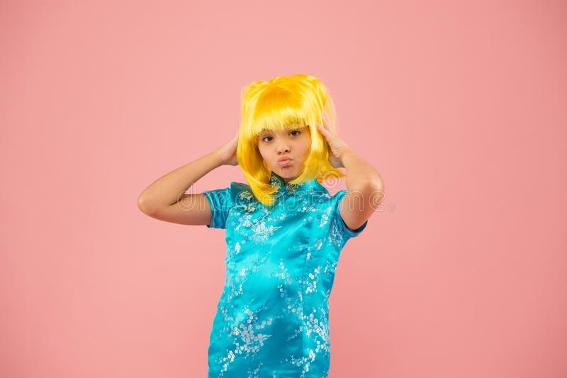 Anime fan. Child cute cosplayer. Anime emotional expression. Anime admirer. Girl yellow wig. Cosplay character concept. Japanese style. Eastern trends for stock photo
