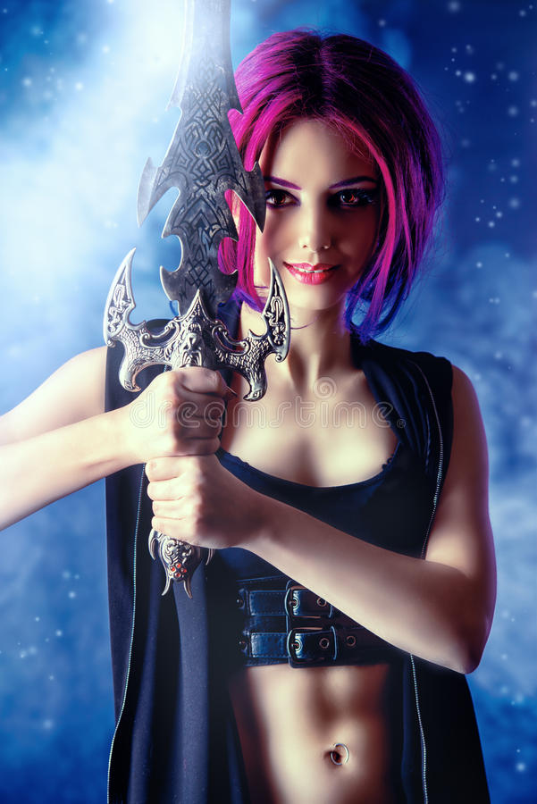Anime girl. Beautiful girl warrior with a sword standing in fighting stance. Anime. Fantasy stock images