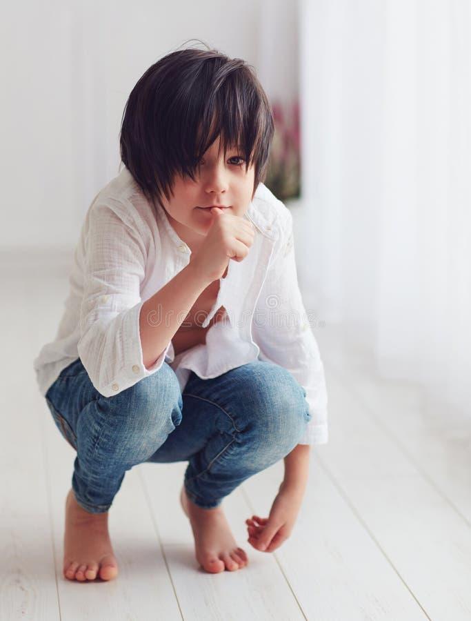 Anime manga young boy character posing barefoot in bright room, sucking his finger. Anime manga young boy character, kid posing barefoot in bright room, sucking stock photos