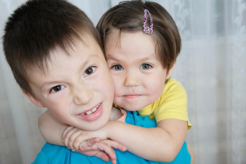 Animosity between brother and sister. siblings children portrait - boy and little girl, together. Family portrait with different age kids. Domestic lifestyle royalty free stock image