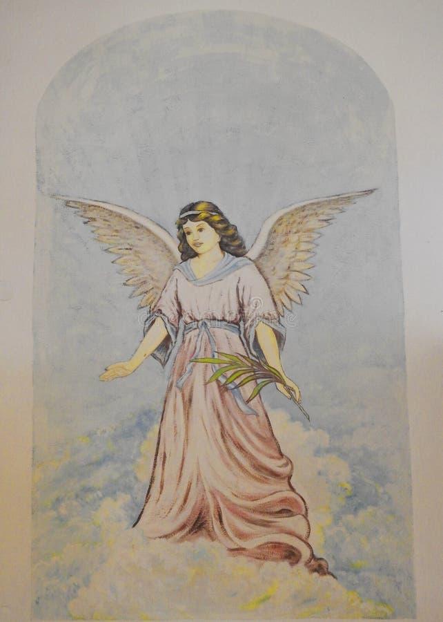 Anioł malujący na kościół ścianie, Lithuania obrazy stock