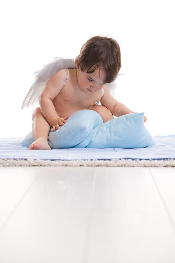 anioła mały poduszek bawić się fotografia stock