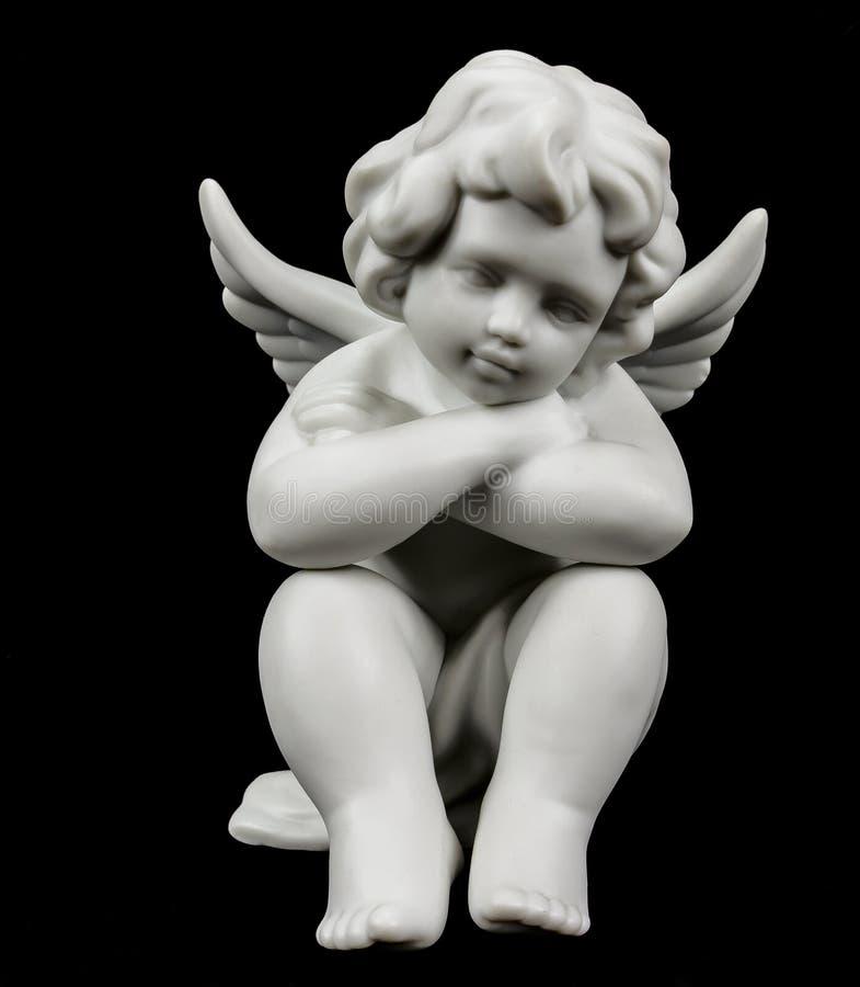 Aniołeczek na czerni obrazy stock