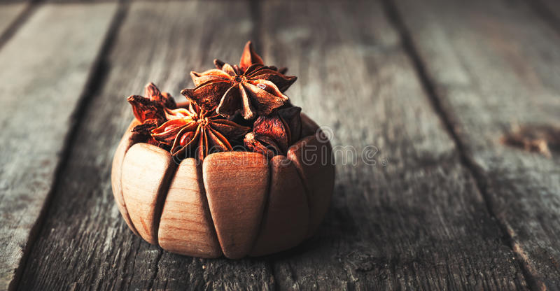 Anis in bowl, dark background. Selective focus royalty free stock images