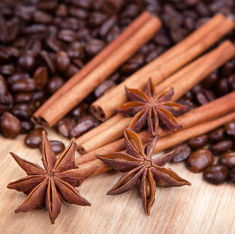Anis, coffee and cinnamon. On a board stock photo