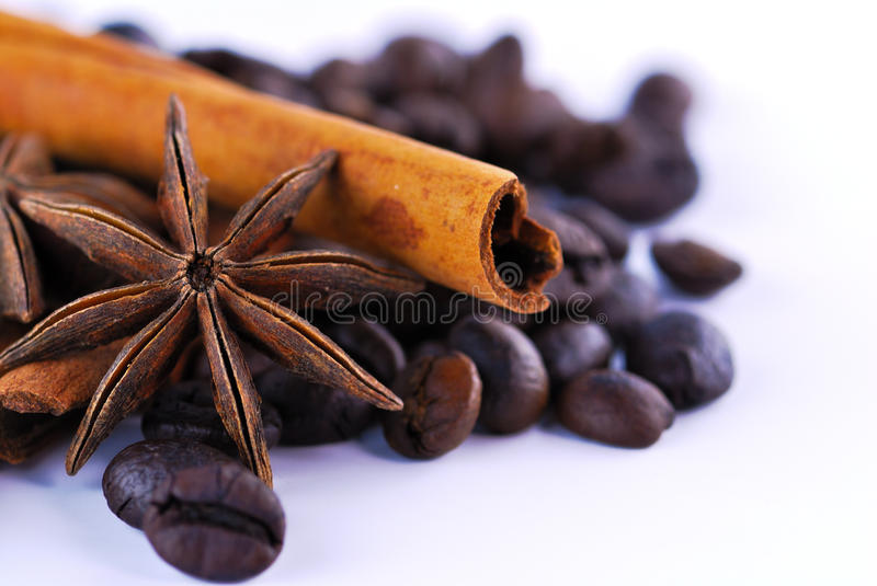Anis, coffee and cinnamon. On white background royalty free stock photos