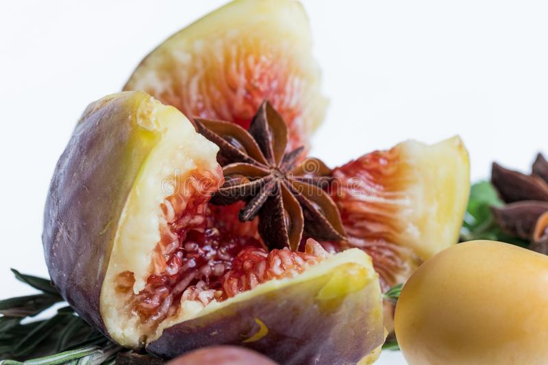 Anise star in heart of fig and date fruit stock images
