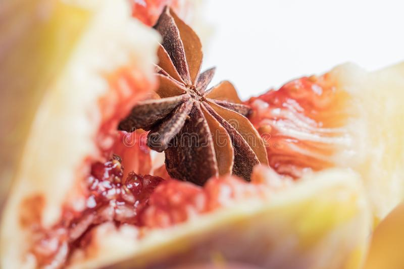 Anise star in heart of fig on left royalty free stock photos