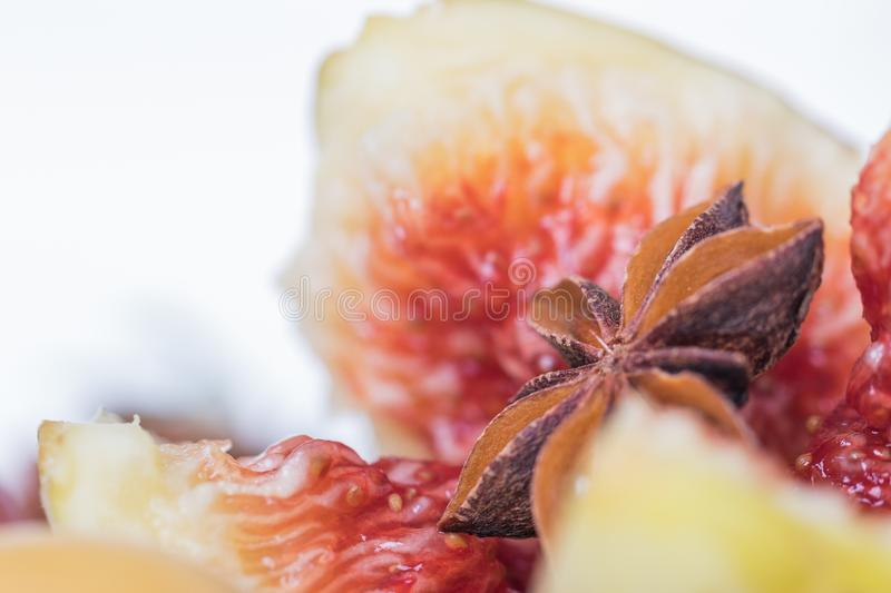 Anise star in heart of fig on right stock photography