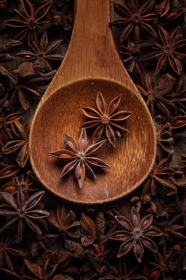 anise in a wooden spoon. Top view. Copy space royalty free stock photos